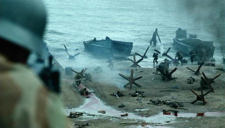 Image features a still from the D-Day landing scene in the film Saving Private Ryan.  The camera is looking over a German soldier firing at allied forces.