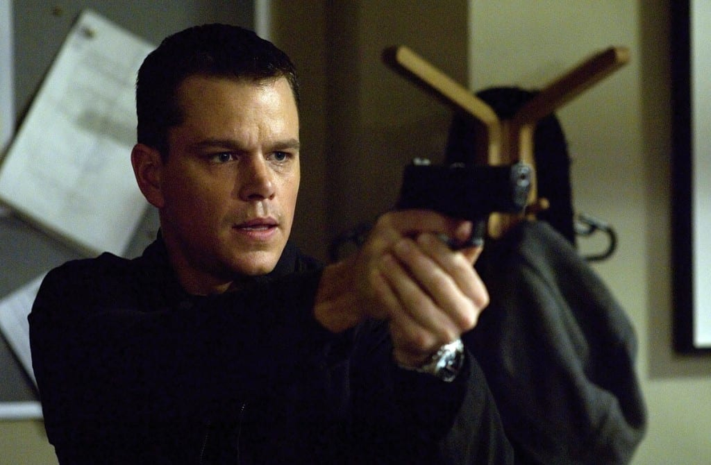 Jason Bourne pointing a handgun.