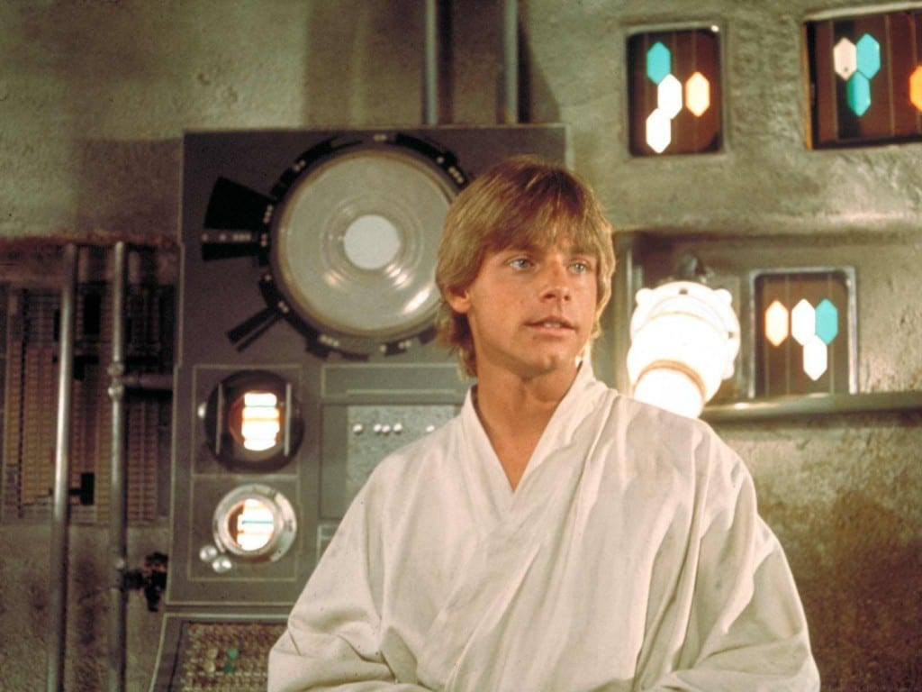Luke Skywalker sitting in a room.