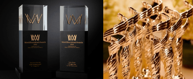 Left is a black and gold award with a square glass top containing a 3D styalised gold soundwave. Right are several CDFA awards, silver statuettes of a female figure.