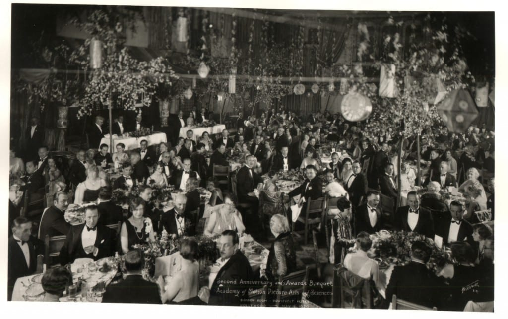 A black and white image a crowded room holding the guests of the first Academy Awards banquet at Roosevelt hotel