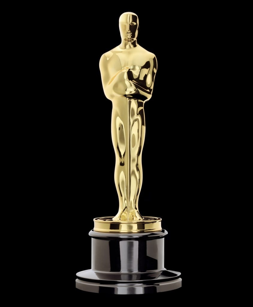 The Oscar Statuette, a gold man holding a sword set on top of a black base.