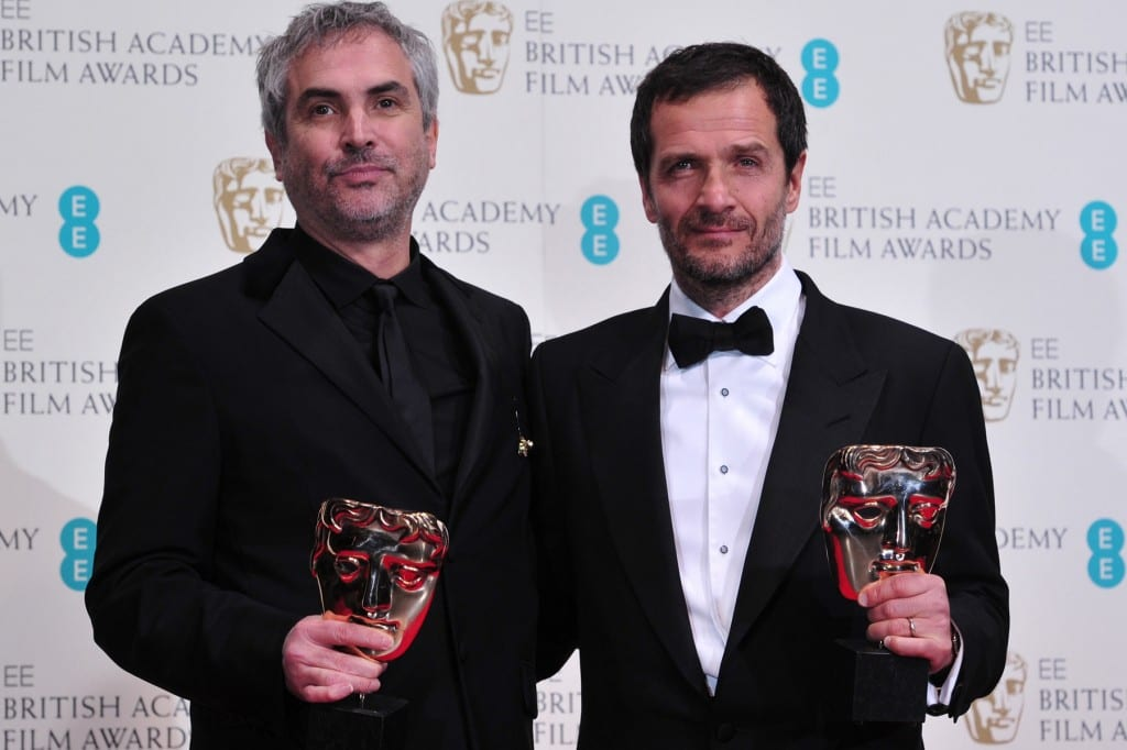 Alfonso and Jonas Cuaron, director and writer for the blockbuster film, Gravity are pictured with 2 of their BAFTA awards.