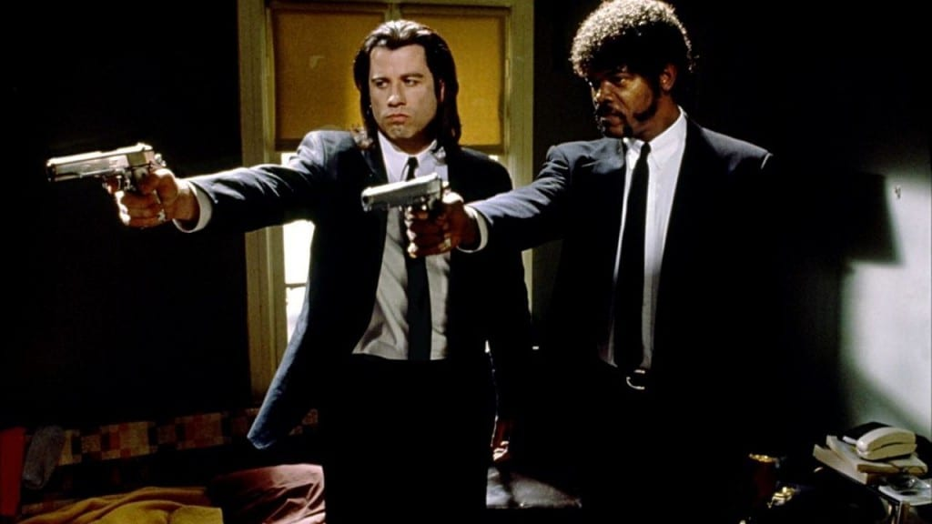 Vincent Vega and Jules Winnfield holding guns