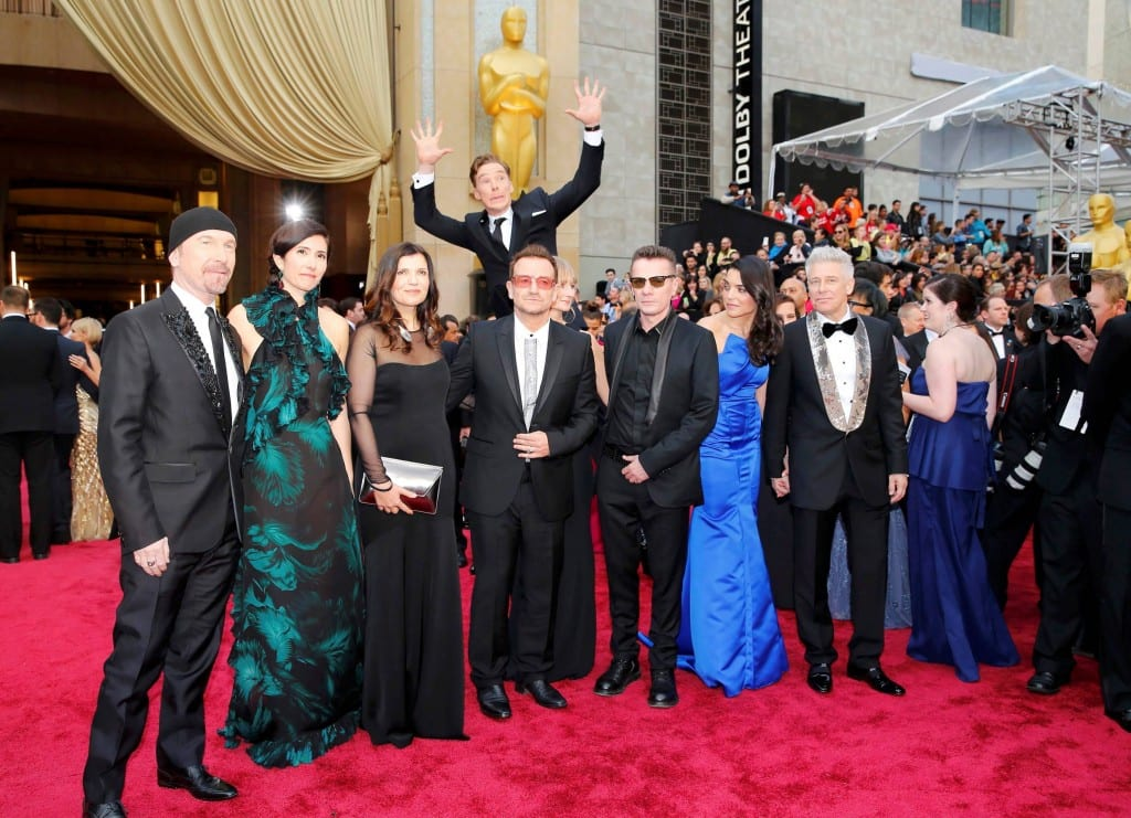 Pictured is the Oscars 2014 red carpet ceremony, where the actor Benedict Cumberbatch is jumping behind the band U2, photobombing them.