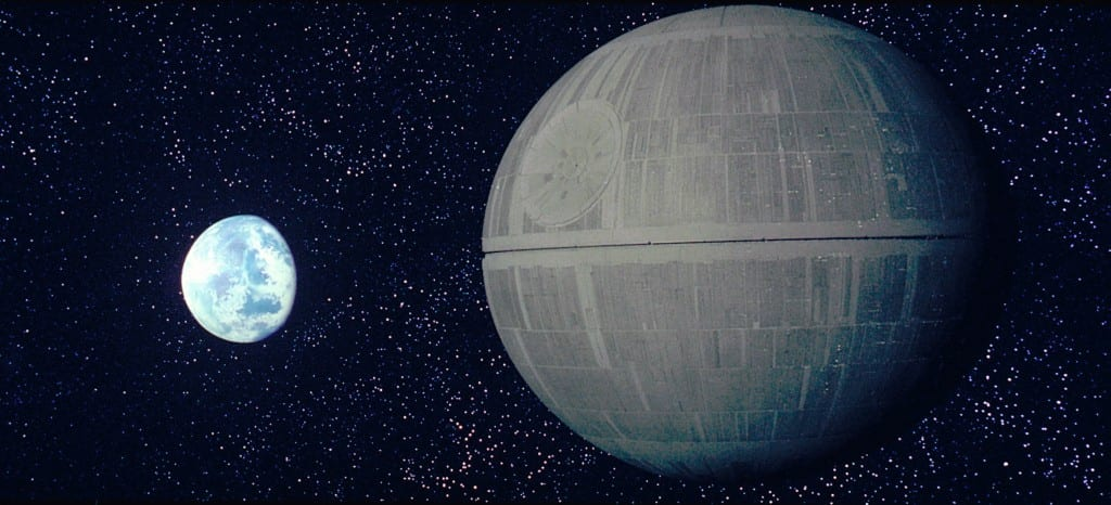 Image shows a large circular space station, the Death Star from the film, Star Wars