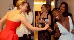 Pictures is the actress Jennifer Lawrence attempting to steal the Oscar for Best Actress from the winner, Lupita N'yongo