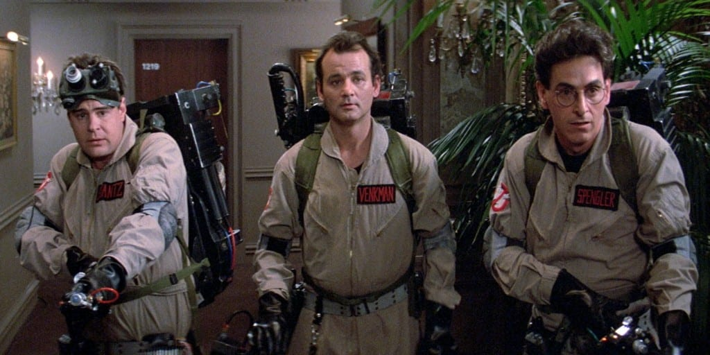 The image shows Billy Murray, Harold Ramis and Dan Aykroyd with their roles in the film, Ghostbusters.