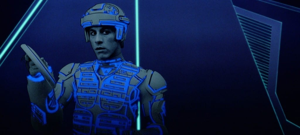 Image shows a character from the movie Tron, holding an identity disc.