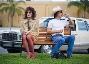 Jared Leto and Matthew McConaughey sitting on a bench in a still from the film Dallas Buyers Club.