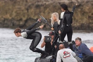 Sam Claflin diving into the ocean while filming a scene with Jennifer Lawrence in Hawaii for The Hunger Games: Catching Fire.