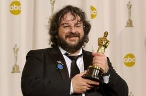 Peter Jackson holding an Oscar statuette at the Academy Awards