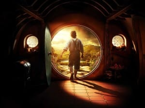 Bilbo the Hobbit walking out of his front door as sun streams in to his house.