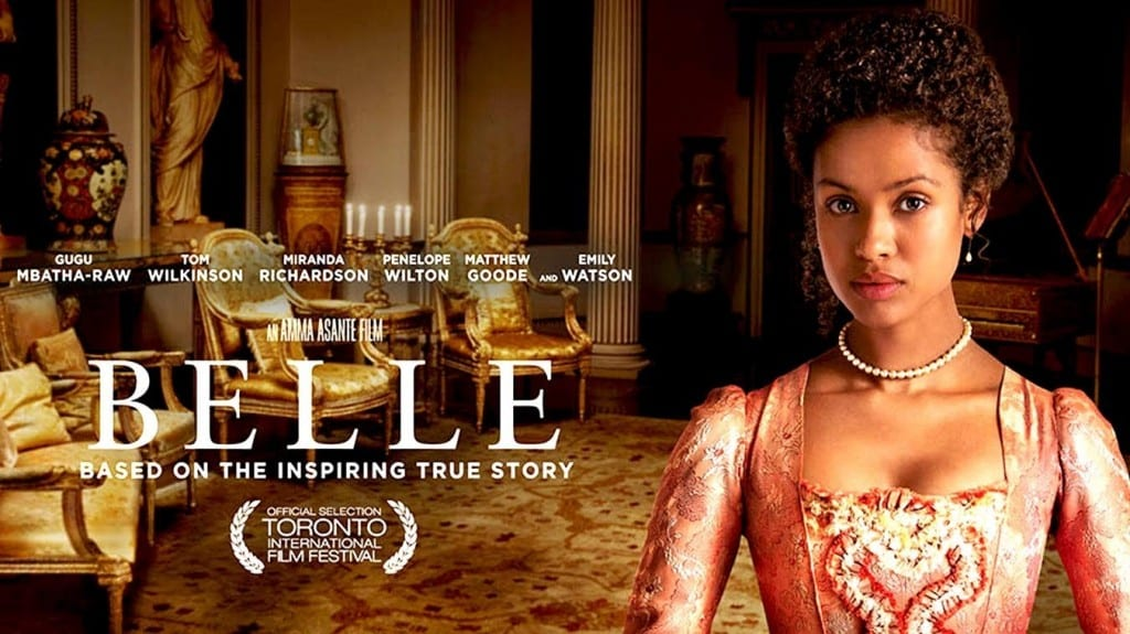 Image shows lead character, Belle in the upcoming movie of the same name. The character is wearing an upper class corset in a mansion.