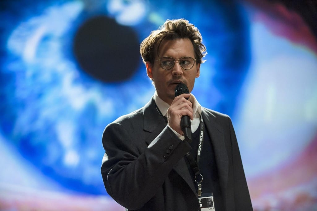 Johnny Depp holding a microphone in a still from the film, 'Transcendence'.