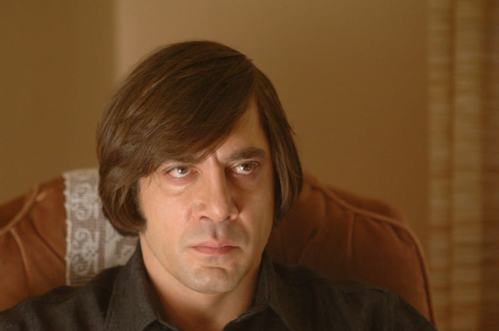 Anton Chigurh sat in a chair.