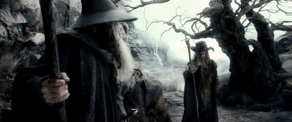 Gandalf and Radagast talking next to a tree.