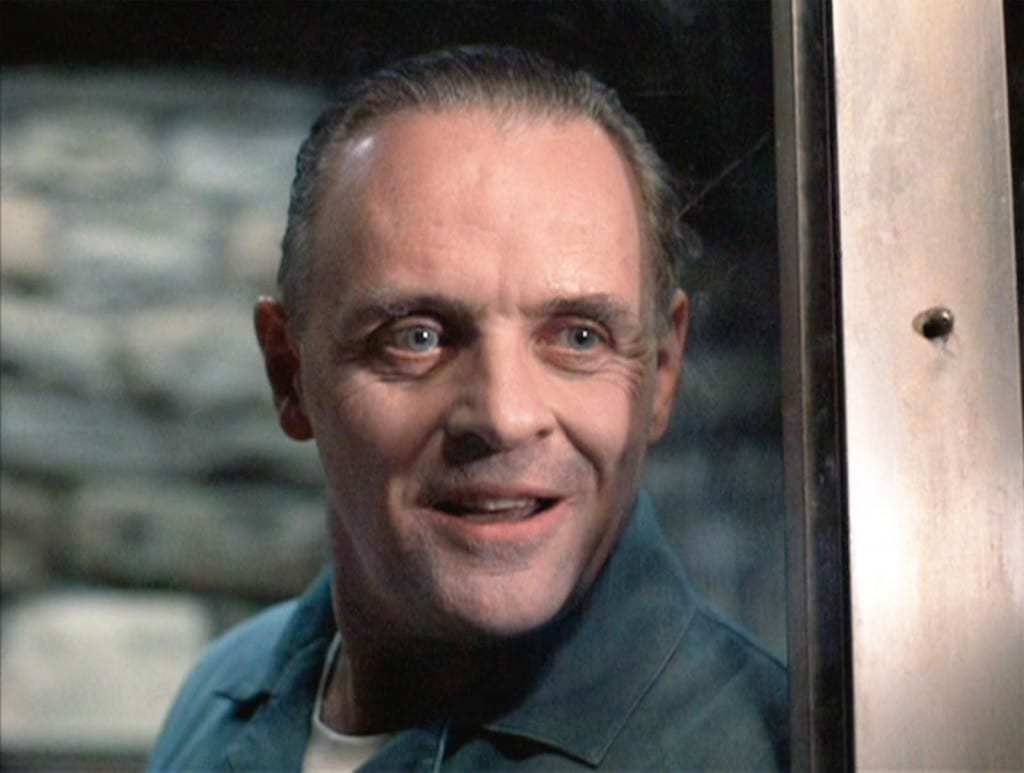 Hannibal Lecter, played by Anthony Hopkins, stood by a door.