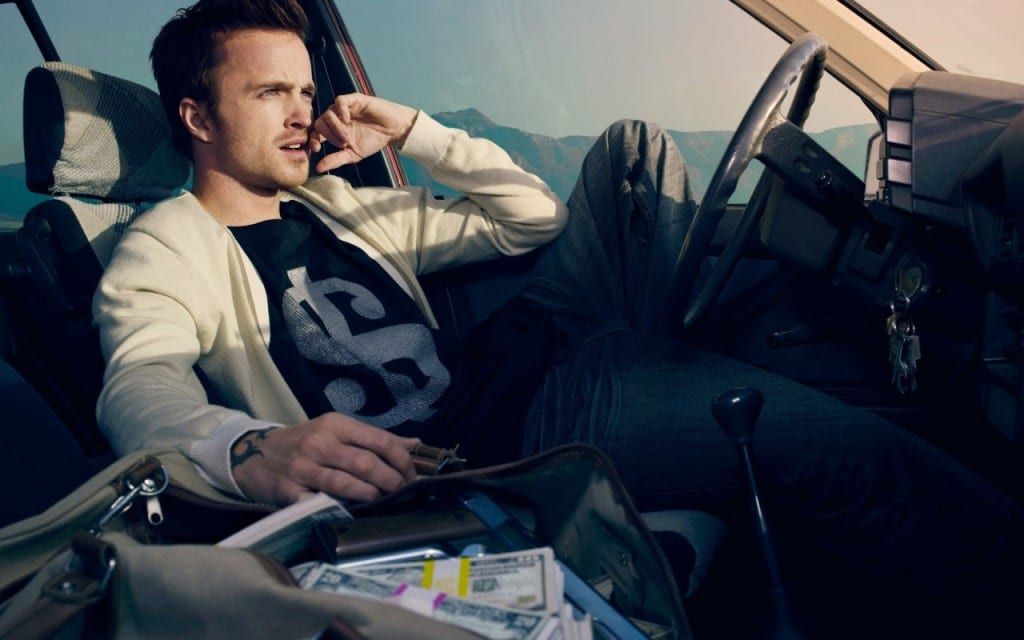 Aaron Paul's character Tobey Marshall sat in a car.