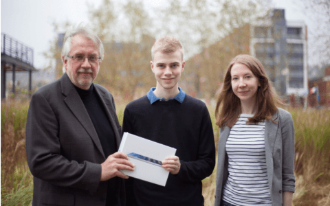 Pictured: Professor Hogue (left) and Research Assistant Rachel Orritt (right) present an IPad Air to the lucky prize winner, Sam Watts.