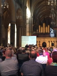 An image of Dr Asbridge delivering his talk in the cathedral