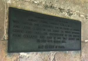 A photograph of Memorial to R. S. Godfrey, Clerk of Works in Cathedral Cloister, south wall.
