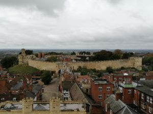 A picture of the view of Lincoln castle from the cathedral roof.