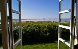 scene of doors opening into a wide horizon