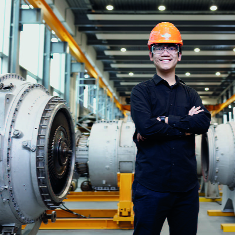 An engineer with turbines