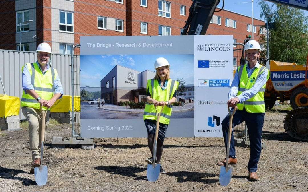 Professor Ian Scowen and Professor Libby John of the University of Lincoln with Ian Taylor, Managing Director of Henry Brothers Midlands, at the official ground breaking for 'The Bridge' Advanced Engineering Research and Development facility