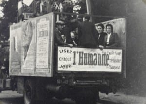 The truck has a sign L'Humanite on its front, as well as on the back and on a poster in the middle on the side, suggesting the lorry was owned by the left-wing newspaper.  The nearest poster on the side includes the word Liberation.