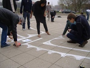 University of Lincoln School of Architecture students drawing a chalk labyrinth