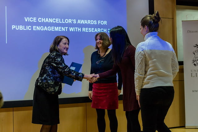 vice chancellor shaking hands with award winners