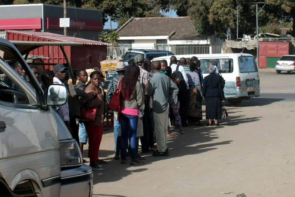 People queuing to use the chapas in Maputo