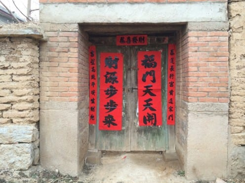 Poetic couplets hung on the door of a village house in preparation for Chinese NewYear (Photo: Tom McDonald)