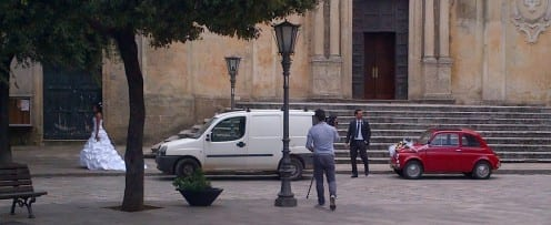 A newly-wed couple from Grano preparing for a photo session at the steps of the church
