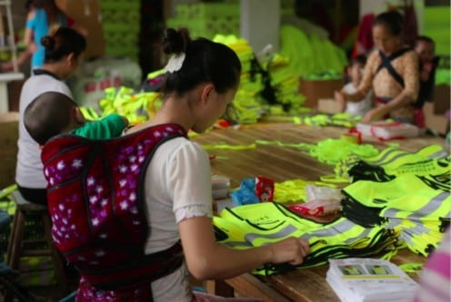 Chinese female migrant workers working in a local reflective vest workshop. Photo by Xinyuan Wang
