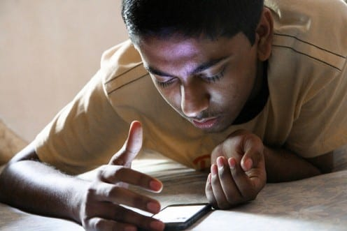 Indian teenager using smartphone