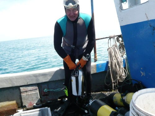 Diver Richard Keen preparing to dive near Guernsey. Image courtesy of Georgina Green.
