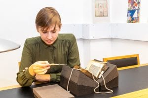 A researcher looking at a rare book in the Special Collections reading room