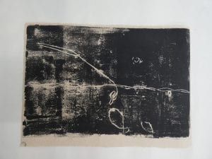 A black and white lino cut print showing a fish swimming towards a fishing hook on a rod.