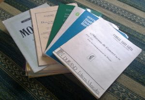a collection of printed music for the French horn