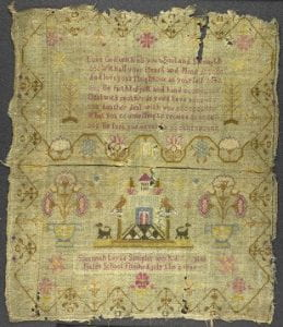 A Sampler with decorative elements