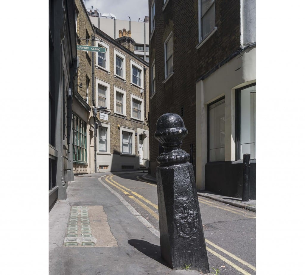 Hanway Street and the Marylebone boundary bollard at the junction with Hanway Place (© Historic England, Chris Redgrave)