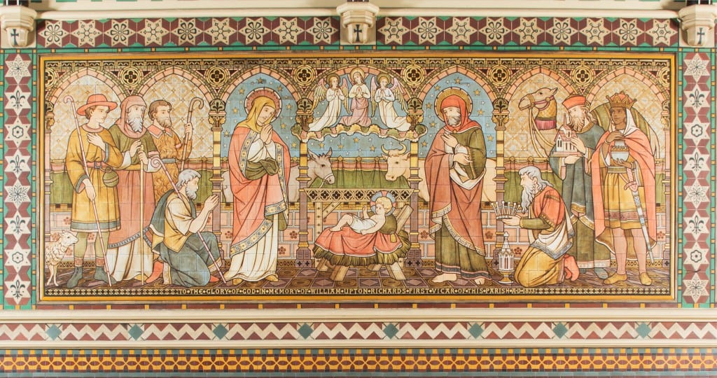 Nativity with six apostles on the lowest row of the reredos. The tilework at All Saints was designed by Butterworth, painted by Alexander Gibbs and executed by Henry Poole & Sons (© Historic England, Chris Redgrave)