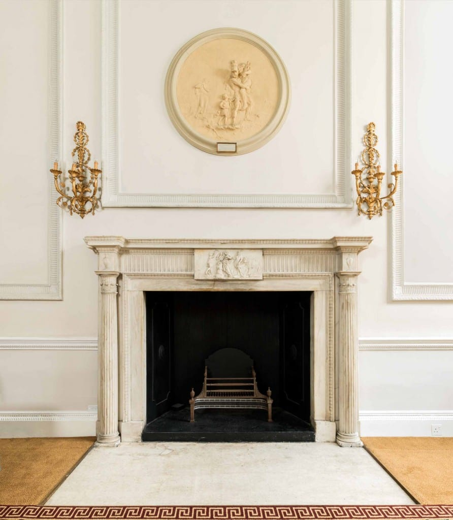 The fireplace in the front room of the ground floor at Chandos House (© Historic England, Chris Redgrave)