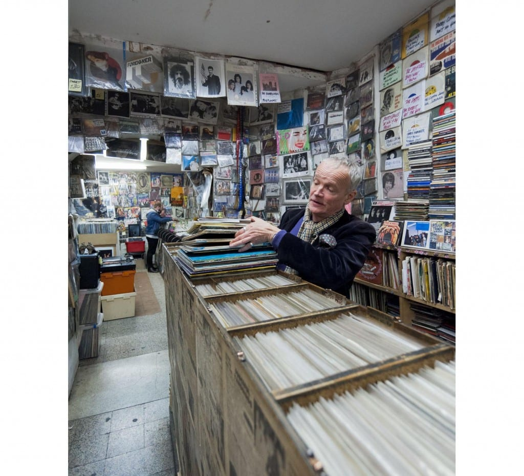 Tim Derbyshire, the owner of the 'On The Beat' Record Shop at 22 Hanway Street in 2014 (© Historic England, Chris Redgrave)