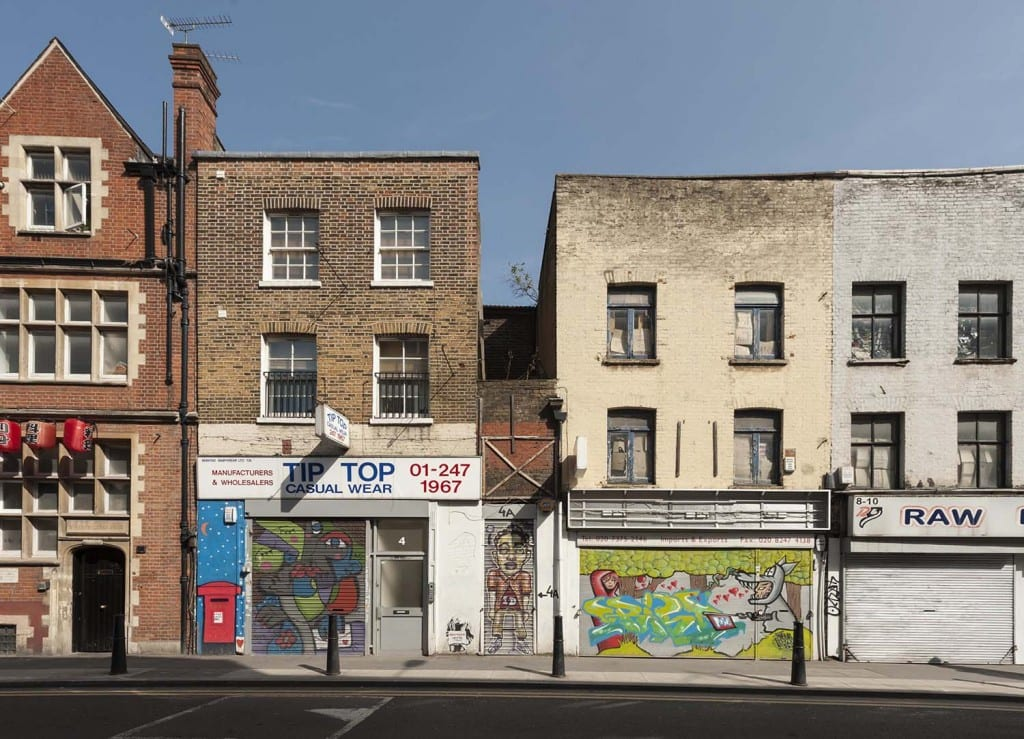 Survey of London - Whitechapel Volume 4-8 White Church Lane, Whitechapel. View from west. 4-8 White Church Lane, buildings of the 1850s with street art of 2012 (© Derek Kendall).