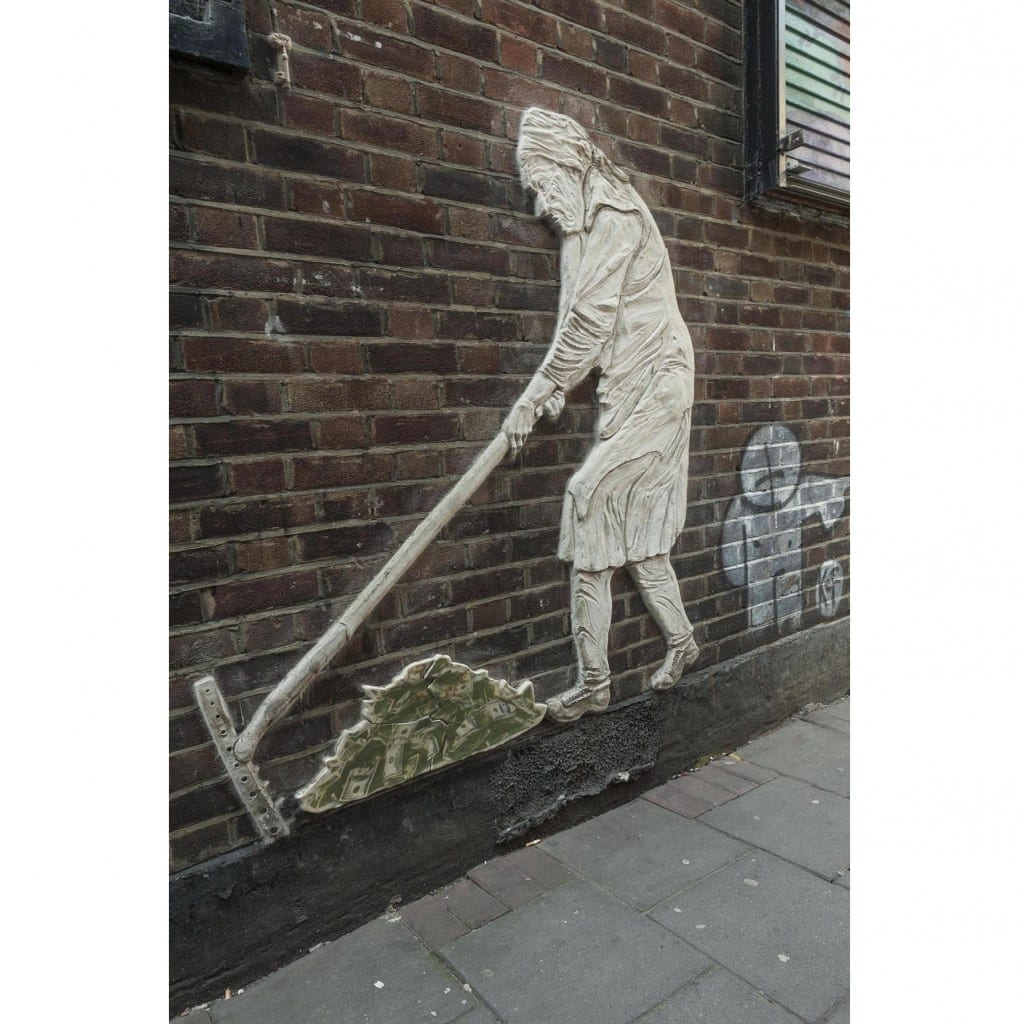 "Survey of London - Whitechapel Volume Whitechurch Passage, Whitechapel. Wall art of old woman raking up money, by artist ""China Girl."""