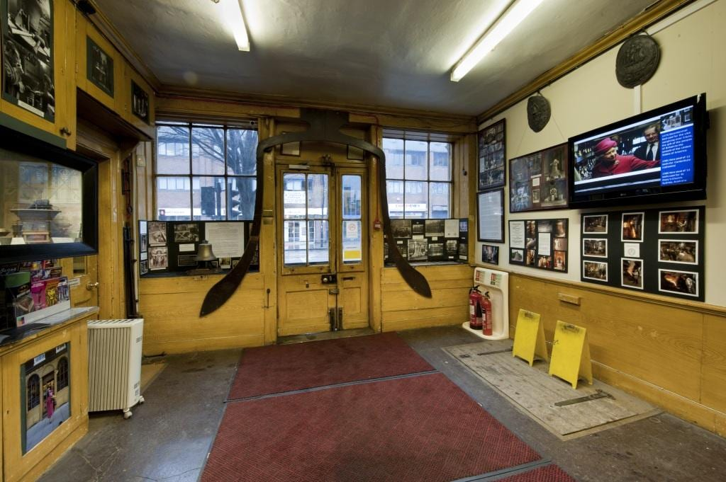 Project: Hidden London Site: Whitechapel Bell Foundry, 32-34 Whitechapel Road, Tower Hamlets, London. Interior of shop with casting profile of Big Ben over door..